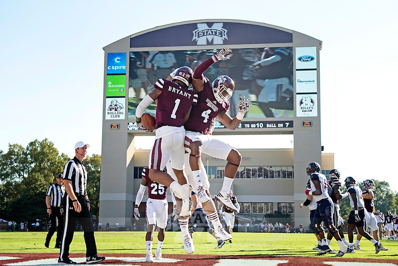 Brandon Bryant celebrating with teammates after an interception.<br />  (photo by Beth Wynn / &copy; Mississippi State University)
