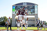Brandon Bryant celebrating with teammates after an interception.<br />  (photo by Beth Wynn / &copy; Mississippi State University)