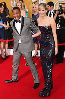 LOS ANGELES, CA - JANUARY 18: Cuba Gooding Jr., Jennifer Lawrence at the 20th Annual Screen Actors Guild Awards held at The Shrine Auditorium on January 18, 2014 in Los Angeles, California. (Photo by Xavier Collin/Celebrity Monitor)