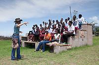 Shannon Hoffman explaining to students of the Mehlokazulu High School Enviro Club during their Nikela sponsored visit..October 2010..African Bird of Prey Sanctuary..Kwazulu-Natal, South Africa.