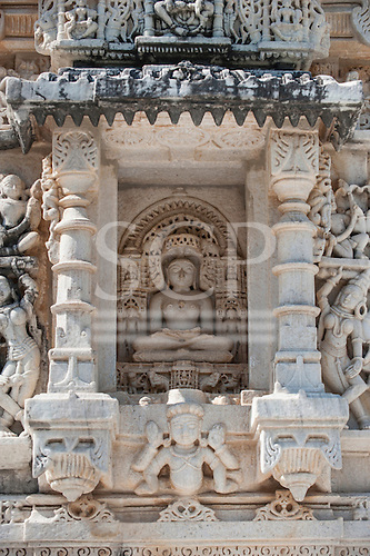 India; road from Udaipur to Jodhpur. Ranakpur Jain Temple. Detail carving. Statue of Ajitnath or Ajitanatha second tirthankara sitting in the lotus position.