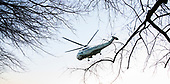 Marine One, with United States President Donald J. Trump, aboard, departs Walter Reed National Military Medical Center in Bethesda, Maryland after spending time with military members and their families on December 21, 2017. <br /> Credit: Chris Kleponis - Pool via CNP