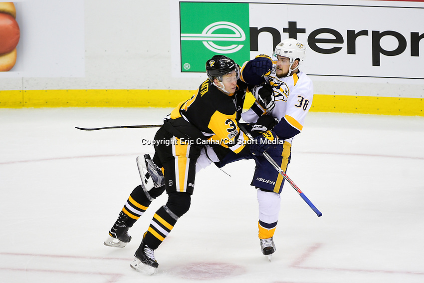 May 29, 2017: Pittsburgh Penguins defenseman Olli Maatta (3) checks Nashville Predators right wing Viktor Arvidsson (38) during game one of the National Hockey League Stanley Cup Finals between the Nashville Predators  and the Pittsburgh Penguins, held at PPG Paints Arena, in Pittsburgh, PA. Pittsburgh defeats Nashville 5-3 in regulation time.  Eric Canha/CSM