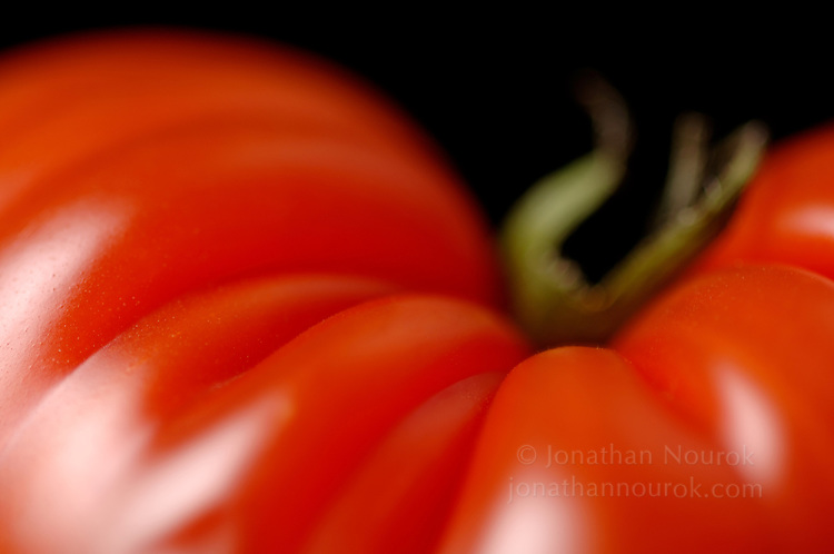 close-up of a tomato  - commercial/editorial licensing for this image is available through: http://www.gettyimages.com/detail/200280232-001/Stone