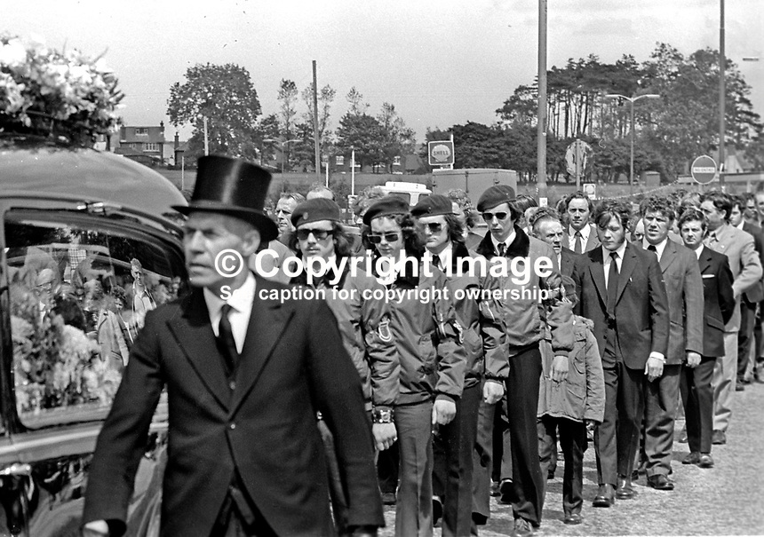 Funeral of UDA member Michael Wilson who was shot by gunmen on 19th June 1973. Michael Wilson lived in the home of his brother-in-law UDA Vice Chairman, Tommy Herron. Herron is married to Wilson's sister. UDA members in para-military uniform follow the hearse. For more information re this killing go page 368 of Lost Lives, a detailed listing of deaths during the N Ireland Troubles. 197306190449b.<br /> <br /> Copyright Image from Victor Patterson, 54 Dorchester Park, Belfast, UK, BT9 6RJ<br /> <br /> t1: +44 28 9066 1296 (from Rep of Ireland 048 9066 1296)<br /> t2: +44 28 9002 2446 (from Rep of Ireland 048 9002 2446)<br /> m: +44 7802 353836<br /> <br /> e1: victorpatterson@me.com<br /> e2: victorpatterson@gmail.com<br /> <br /> The use of my copyright images is subject to my Terms &amp; Conditions.<br /> <br /> It is IMPORTANT that you familiarise yourself with them. They are available on my website at www.victorpatterson.com.<br /> <br /> None of my copyright images may be used on a website unless they are visibly watermarked, i.e. &copy; Victor Patterson within the body of the visible image. Metadata denoting my copyright must NOT be deleted. <br /> <br /> Web use (maximum size - 400 kb) is extra at currently recommended NUJ rates.