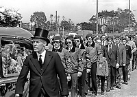 Funeral of UDA member Michael Wilson who was shot by gunmen on 19th June 1973. Michael Wilson lived in the home of his brother-in-law UDA Vice Chairman, Tommy Herron. Herron is married to Wilson's sister. UDA members in para-military uniform follow the hearse. For more information re this killing go page 368 of Lost Lives, a detailed listing of deaths during the N Ireland Troubles. 197306190449b.<br /> <br /> Copyright Image from Victor Patterson, 54 Dorchester Park, Belfast, UK, BT9 6RJ<br /> <br /> t1: +44 28 9066 1296 (from Rep of Ireland 048 9066 1296)<br /> t2: +44 28 9002 2446 (from Rep of Ireland 048 9002 2446)<br /> m: +44 7802 353836<br /> <br /> victorpattersonbelfast@gmail.com<br /> victorpatterson@me.com<br /> <br /> www.victorpatterson.com<br /> <br /> Please see my Terms and Conditions of Use at https://www.victorpatterson.com/page2<br /> It is IMPORTANT that you familiarise yourself with them.<br /> <br /> Images used on the Internet incur an additional cost and must be visibly watermarked i.e. © Victor Patterson within the body of the image and copyright metadata must not be deleted. Images used on the Internet have a size restriction of 4kbs and are chargeable at rates available at victorpatterson.com.<br /> <br /> This image is available only for the use of the download recipient i.e. television station, newspaper, magazine, book publisher, etc, and must not be passed on to any third party. It is also downloaded on condition that each and every usage is notified within 7 days to victorpatterson@me.com<br /> <br /> The right of Victor Patterson (or the named photographer) to be identified as the author is asserted in accordance with The Copyright Designs And Patents Act (1988). All moral rights are asserted.