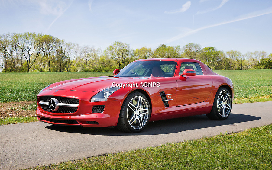 BNPS.,co.uk (01202 558833)<br /> Pic: SilverstoneAuctions/BNPS<br /> <br /> 2010 SLS AMG sold for £203,000.<br /> <br /> British collecter in Million pound double swoop on two super rare 'Gullwing' Mercedes at classic car auction.<br /> <br /> Two distinctive Mercedes 'Gullwing' cars have sold for over £1m - to the same buyer.<br /> <br /> One of the motors was a classic 1954 coupe, the Mercedes SL300 Gullwing, that went under the hammer for a whopping £832,000.<br /> <br /> The other, a modern 2010 Mercedes SLS AMG which had done only 690 miles, fetched over £203,000.<br /> <br /> The Mercedes SL300 Gullwing was an instant hit on its release thanks in part to its iconic lifting doors.<br /> <br /> Around 1,400 Gullwings were made between 1954 and 1963, the vast majority of which were exported to the US.