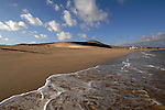 Waves lapping on the golden beaches of Playa de Sotavento de Jandia, Fuerteventura, Canary Islands, Spain.