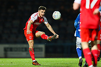 Lewie Coyle of Fleetwood Town clears during the Sky Bet League 1 match between Rochdale and Fleetwood Town at Spotland Stadium, Rochdale, England on 20 March 2018. Photo by Thomas Gadd.