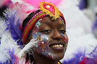 UNITED KINGDOM, London: A performer dance during the first day of the Notting Hill Carnival in west London on August 30, 2015.