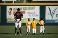 Modesto Nuts left fielder Gareth Morgan (44) with youth league baseball players during the National Anthem before a California League game against the Lake Elsinore Storm at John Thurman Field on May 11, 2018 in Modesto, California. Modesto defeated Lake Elsinore 3-1. (Zachary Lucy/Four Seam Images)