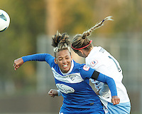 Boston Breakers forward Lianne Sanderson (10) and Chicago Red Stars midfielder Leslie Osborne (12) battle for head ball.  In a National Women's Soccer League Elite (NWSL) match, the Boston Breakers (blue) defeated Chicago Red Stars (white), 4-1, at Dilboy Stadium on May 4, 2013.