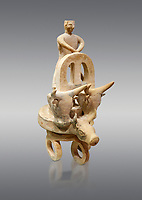 Minoan cult model of a 3 wheeled chariot drawn by a bull with a charioteer,  Karphi Sanctuary 1200-1100 BC, Heraklion Archaeological Museum, grey background. <br /> <br /> During this period both Minoan and Mycenaean graves were found in Karphi snctuary so these cult gods are attributable to both cultures