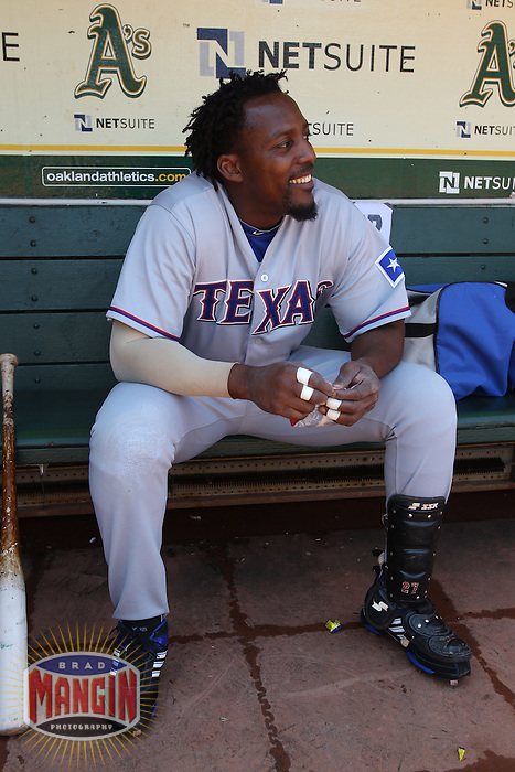 OAKLAND, CA - AUGUST 7:  Vladimir Guerrero of the Texas Rangers gets ready in the dugout before the game against the Oakland Athletics at the Oakland-Alameda County Coliseum on August 7, 2010 in Oakland, California. Photo by Brad Mangin