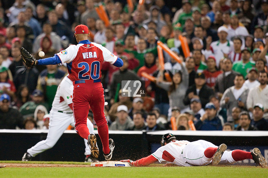 16 March 2009: #10 Karim Garcia of Mexico slides head first into first base safely as he beats the throw from #20 Norge Luis Vera of Cuba during the 2009 World Baseball Classic Pool 1 game 3 at Petco Park in San Diego, California, USA. Cuba wins 7-4 over Mexico.
