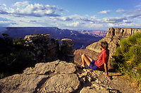 Man enjoying South rim view of Grand Canyon in Arizona, USA