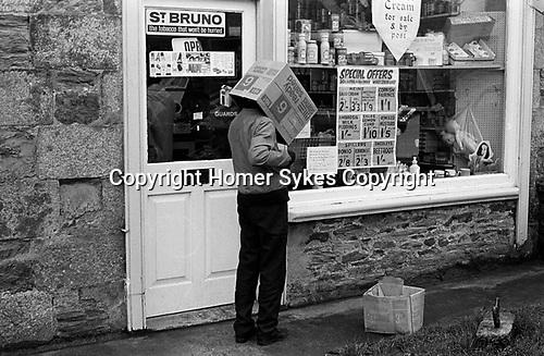 Boy with box on head Cornwall 1970 UK