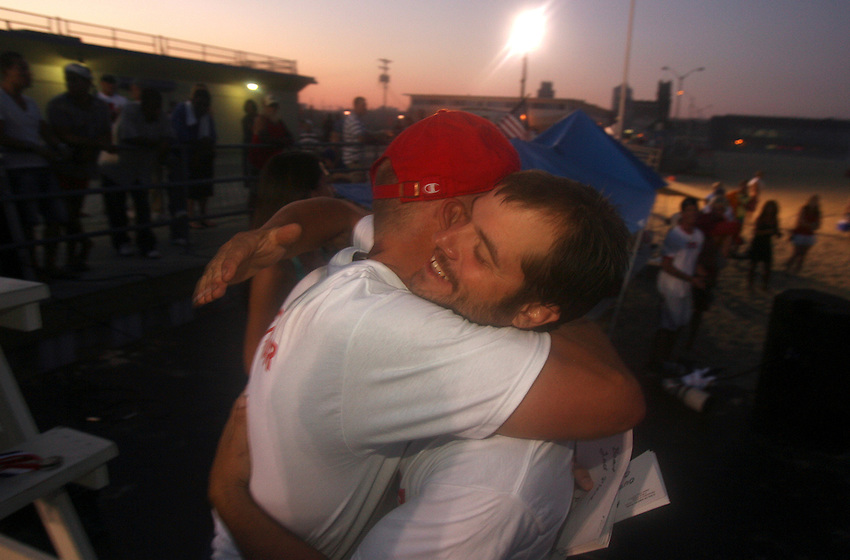 "Tournament organizer Dave Healy (left) embraces fellow Asbury Park competitor Paul ""Bug"" Elyssev  during the awards ceremony after the First Annual Asbury Park Beach Bar Lifeguard Competition held at the 3rd Avenue beach in Asbury Park. ASBURY PARK, NJ  8/4/07  8:21:47 PM  PHOTO BY ANDREW MILLS"