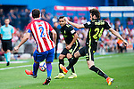 Atletico de Madrid's player Diego Godín and Sporting de Gijon's Douglas and Duje Cop during a match of La Liga Santander at Vicente Calderon Stadium in Madrid. September 17, Spain. 2016. (ALTERPHOTOS/BorjaB.Hojas)