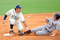 2 May 2010:  FIU's Garrett Wittels (10) loses the ball while attempting to tag out ULM's Josh Gill (8), who successfully stole second base in the second inning as the University of Louisiana-Monroe Warhawks defeated the FIU Golden Panthers, 8-7 in 11 innings, at University Park Stadium in Miami, Florida.