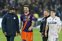 Kyle Walker of Manchester City (2nd L) with Billy Reid, assistant manager for Swansea and Daniel James of Swansea City walk off the pitch after the final whistle during the Emirates FA Cup match between Swansea City and Manchester City at the Liberty Stadium, Swansea, Wales, UK. Saturday 16 March 2019