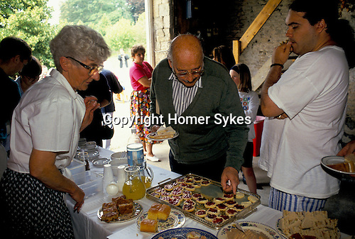 'ENGLISH VILLAGE FETE', TEA AND CAKES ARE SOLD FROM ONE OF THE BARNS ADJOINING BOUTHROP HOUSE.