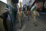 Palestinian Christian's Scouts march in the Manger Suare next to the Church of the Nativity, the traditionally excepted birthplace of Jesus Christ, during the annual Christmas celebrations in the west Bank town of Bethlehem, 24 December 2009. The head of the Roman Catholic Church in the Holy Land, Patriarch Fouad Twal, arrived in Bethlehem, ahead of Christmas celebrations in the city revered as the birthplace of Jesus Christ. Photo by Mohamar Awad