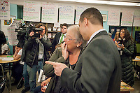NYC Dept. of Education Chancellor Carmen Fariña speaks with Principal Dr. Ramon Gonzalez during her visit to MS 223, The Laboratory School of Finance and Technology, in the Bronx borough of New York on Thursday, January 2, 2014, her first day of work. New York Mayor Bill De Blasio appointed career educator Fariña as the head of the New York City public school system.  (© Richard B. Levine)
