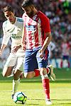 Real Madrid's Raphael Varane (l) and Atletico de Madrid's Diego Costa during La Liga match. April 8,2018. (ALTERPHOTOS/Acero)