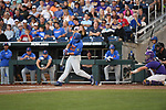 OMAHA, NE - JUNE 26: Austin Langworthy (44) of the University of Florida hits for a double against Louisiana State University during the Division I Men's Baseball Championship held at TD Ameritrade Park on June 26, 2017 in Omaha, Nebraska. The University of Florida defeated Louisiana State University 4-3 in game one of the best of three series. (Photo by Justin Tafoya/NCAA Photos via Getty Images)