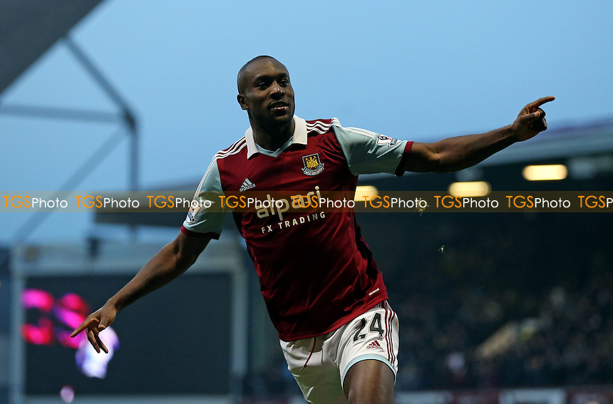 Carlton Cole celebrates after scoring the 1st goal for West Ham - West Ham United vs Arsenal, Barclays Premier League at Upton Park, West Ham - 26/12/13 - MANDATORY CREDIT: Rob Newell/TGSPHOTO - Self billing applies where appropriate - 0845 094 6026 - contact@tgsphoto.co.uk - NO UNPAID USE