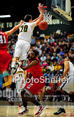 12 December 2010: University of Vermont Catamount guard Brendan Bald (20), a Sophomore from Millersville, MD, in action against the Marist College Red Foxes at Patrick Gymnasium in Burlington, Vermont. The Catamounts (7-2) defeated the Red Foxes  75-67 notching their 7th win of the season, and their best start since the '63-'64 season. Mandatory Credit: Ed Wolfstein Photo