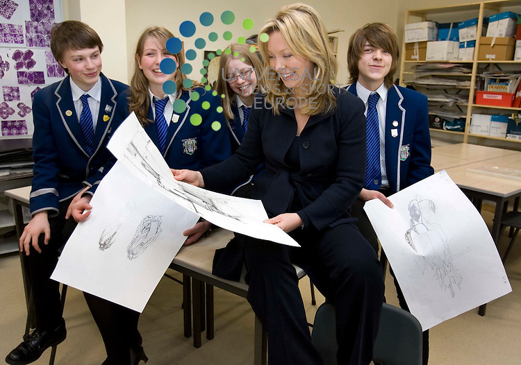 Broadcaster and former pupil Kirsty Young looking at her old art work with pupils from left to right Lawrance Smith, 16 and Juliet Montgomery, 17 and Elspeth Coates 16, and far left Joshua McIntyre attend the opening of Stirling High School. The school has undergone a £100m refurbishment..Picture: Universal News And Sport (Scotland) 26 June 2008............ ........... .