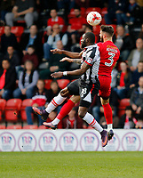Leyton Orient's Callum Kennedy and Grimsby Town's Tom Bolarinwa challenge for the ball during the Sky Bet League 2 match between Leyton Orient and Grimsby Town at the Matchroom Stadium, London, England on 11 March 2017. Photo by Carlton Myrie / PRiME Media Images.