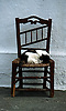 cat sleeps on chair<br /> <br /> gato dormiendo en una silla<br /> <br /> Katze schl&auml;ft auf Stuhl<br /> <br /> Original: 35 mm slide transparency