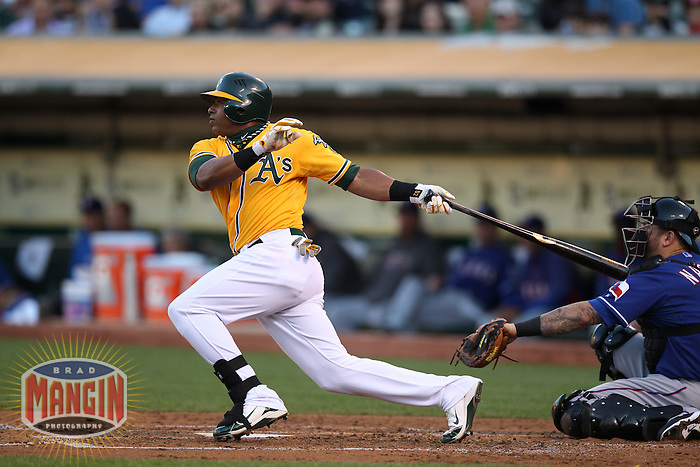OAKLAND, CA - JULY 17:  Yoenis Cespedes #52 of the Oakland Athletics bats against the Texas Rangers during the game at O.co Coliseum on Tuesday, July 17, 2012 in Oakland, California. Photo by Brad Mangin