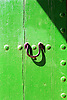 detail of a green painted wooden door with knocker <br /> <br /> detalle de una puerta de madera pintada en verde con llamador<br /> <br /> Detail einer grünen Holztür mit Klopfer<br /> <br /> 2480 x 1655 px<br /> Original: 35 mm