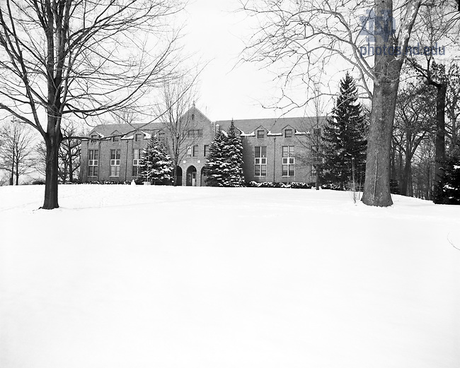 GPHR 45/0027:  Holy Cross Hall exterior in winter with snow, 1970/1230..Image from the University of Notre Dame Archives.