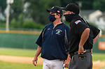WATERBURY, CT-071520JS20—A member of the Simsbury SaberCats, talks with the umpire prior to their game against the Brass City Bombers  during their summer college league game Wednesday at Municipal Stadium in Waterbury. Both then coach and umpire wore masks when they were close to one another. <br /> Jim Shannon Republican-American