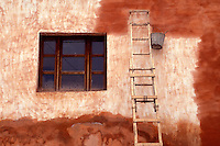 Homemade painter's ladder and colorful wall  in San Miguel de Allende, Mexico. San Miguel de Allende is a UNESCO World Heritage site...