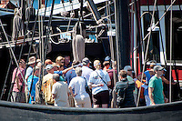 Hundreds lined the boardwalk at Tin City waiting to climb aboard the Nina and Pinta, replicas of Christopher Columbus ships, and take self-guided tours.  The floating museums will be open every day from 9 am to 6 pm, through April 10. General admission is $8 for adults, $7 for seniors (age 60 plus), $6 ages 5-16, children under 4 are free. Photo by Debi Pittman Wilkey