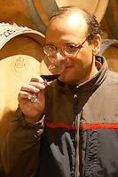 Eduardo Boido oenologist and winemaker wine maker tasting a glass of wine in the cellar Bodega Bouza Winery, Canelones, Montevideo, Uruguay, South America
