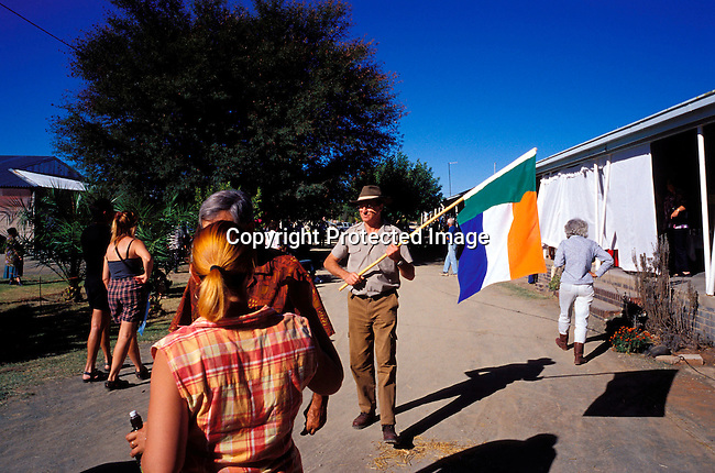 DIPOAFR00056.Culture Afrikaners An unidentified man carrying the old Transvaal 4 colour flag at the Orania show, in Orania and all white Afrikaner community in Northern Cape , South Africa..Photo: Per-Anders Pettersson/ iAfrika Photos
