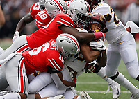 Minnesota Golden Gophers defensive back Benny Sapp III (22) is tackled by a mass of Ohio State Buckeyes in the first half of their game at Ohio Stadium in Columbus, Ohio on October 13, 2018. [ Brooke LaValley / Dispatch ]