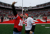 Usually seated near the top of the stadium for games, Brent Massie, 41, left, and Jeff Glorioso, 41, both from Columbus, take a selfie on the field prior to the celebration for Ohio State winning the national championship at Ohio Stadium on Jan. 24, 2015. (Adam Cairns / The Columbus Dispatch)