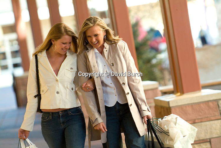 Mother and daughter, shopping and laughting