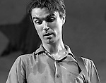David Byrne of the music group Talking Heads performs onstage in Central Park in New York City in August, 1979.