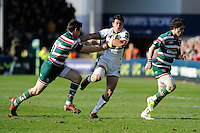 George Pisi of Northampton Saints (centre) hands off Matt Smith of Leicester Tigers (left) as Horacio Agulla of Leicester Tigers supports during the LV= Cup Final match between Leicester Tigers and Northampton Saints at Sixways Stadium, Worcester on Sunday 18 March 2012 (Photo by Rob Munro, Fotosports International)