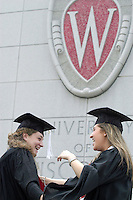 Graduating seniors Jodie Goldberg (L) and Lindsay Fogel (R) embrace following a spring commencement ceremony in the Kohl Center. A total of 4,441 students graduated from the University of Wisconsin-Madison this year.<br /> <br /> Client: University of Wisconsin-Madison<br /> &copy; UW-Madison University Communications 608-262-0067<br /> Photo by: Michael Forster Rothbart<br /> Date:  5/03    File#:   D100 digital camera frame 5447.