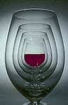 Wine glasses reflected with red wine